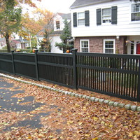 Cedar fence stepped to follow grade