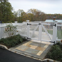 Cedar fence stained white